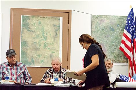 Chantelle Begay, the new secretary for the Flathead Joint Board of Control, distributes information during the Sept. 12 meeting.