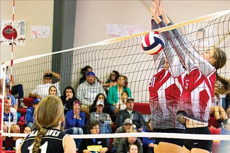 Arlee Scarlets battle at the net during the Spike It Tourney.