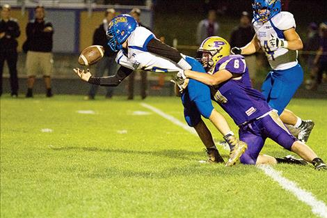 Polson Pirate Haden Smith sacks the Loggers' quarterback.