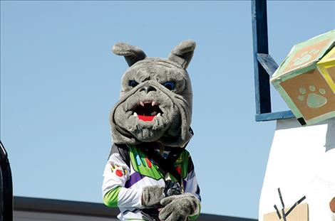 Mission Bulldog's  mascot rides on a float.