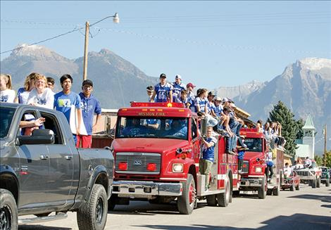 Mission students circle the town during the homecoming parade on Friday.