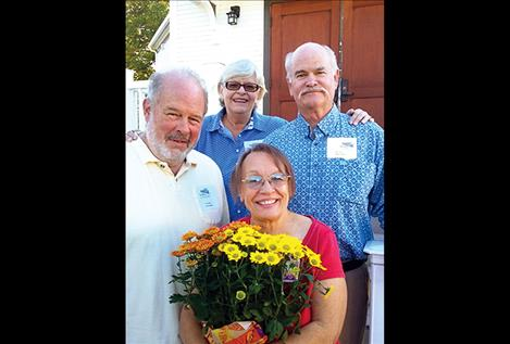 Steve Sherick and Karen Dunwell, left, honored Bill Olson, past president, and Gay Cochran, manager, of the Flathead Historical Museum.