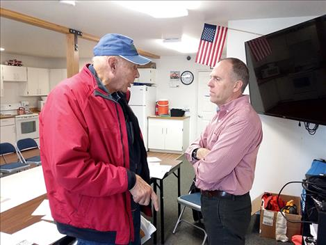 Polson resident Chuck Jarecki talks with State Rep. Greg Hertz on Friday after the Pachyderm Club meeting.
