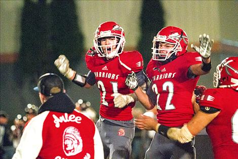 The Arlee Warriors celebrate a victory.