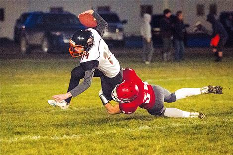 Arlee Warrior George Shick sacks the Plains' quarterback.
