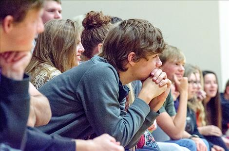 Charlo  students listen to speakers during an assembly.