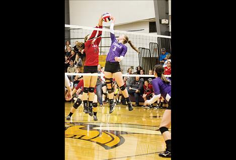 Lady Viking Teaira  Truman battles at the net.