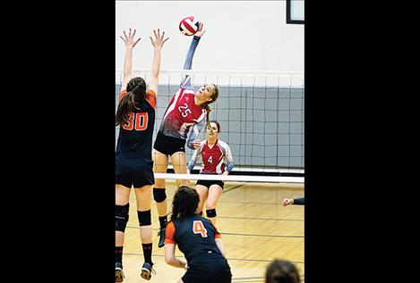 Scarlet Ashely Revis skies above the net during district play Oct. 26.