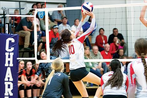 Pirate Kaelyn Smith battles an opponent at the net during a home game Oct. 7.