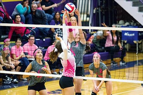 Scarlet Tomi Brazill taps it over the net during district play Oct. 27