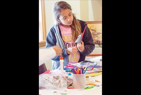 Carla Morigeau, 10, makes a turkey craft project hosted by a new group called Arlee Youth Connection.