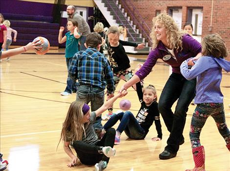 Shauna Rubel of Glacier Bank plays a game of dodgeball at Linderman during a school event held to recognize third grade Students in Good  Standing.
