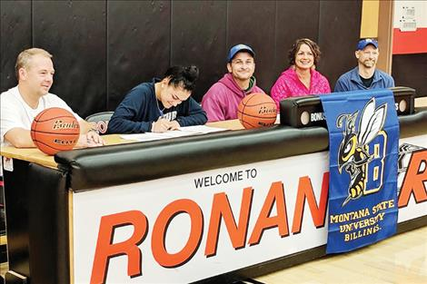 Micalann McCrea signs her letter of intent to play basketball at MSU Billings.