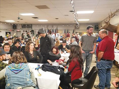 The community gathers to support the Cross family at a recent fundraising spaghetti dinner in Polson.