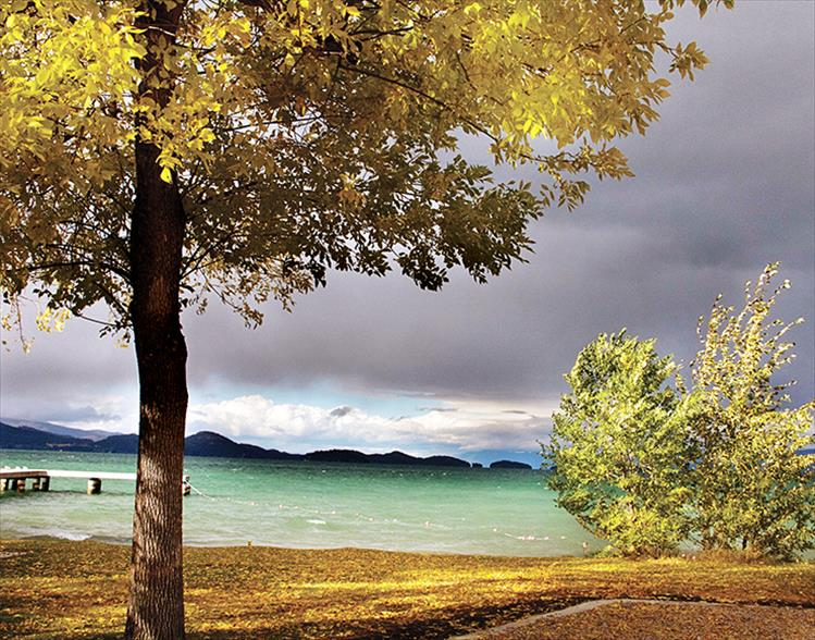 High winds warn of approaching rainy weather from across Flathead Lake.