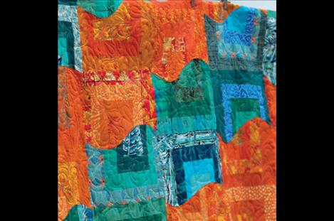 Teal and tangerine describe this Carl Rohr quilt's vivid colors.