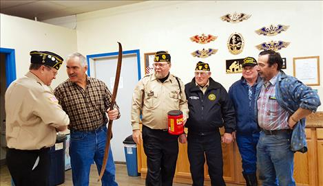 Custom bow creator Dan Toelke congratulates Tom Leafty, winner of the Veterans Day raffle drawing. Pictured left to right are: Tom Leafty, Dan Toelke, Glen Sharbono, Ed Cornelius, Garry Hoffer and Kim Aipperspach.