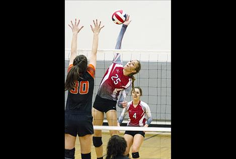 Arlee Scarlets Ashley Revis (25) and Eden Morin (4)