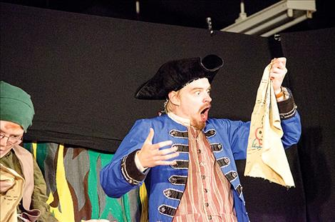 MCT Actor Eric Rhodes looks at the treasure map.