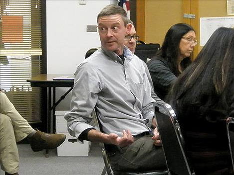 Tom Woolf, Aquatic Invasive Species bureau chief with Montana Fish, Wildlife and Parks, answers a question at the Nov. 12 Flathead Basin Commission meeting in Polson.