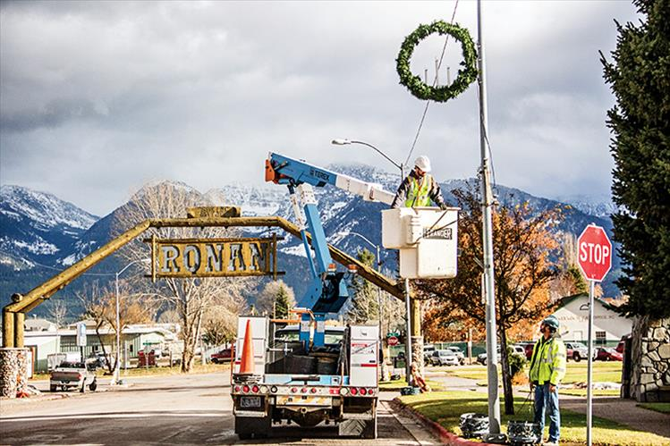 Access Montana employees once again put up holiday lights on Main Street in Ronan.