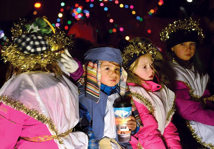 Children enjoy last year's parade of lights.