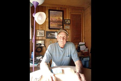 Charlie Jacquier of St. Ignatius reminisced recently with a neighbor about his military service and the the battle of Iwo Jima.
