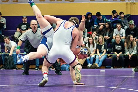Mission Bulldog Gus Bosley upends his opponent during the title round of the Owen Invitational.