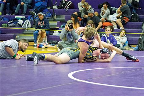 Polson Pirate Parker Adler wraps up his opponent during the title round of the Owen Invitational.
