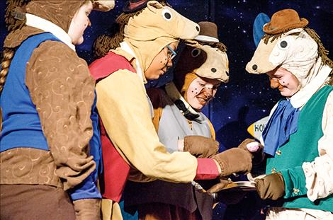 Four horses from a distant planet celebrate tea time