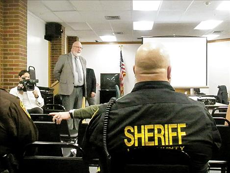 Jail Captain Joel Shearer, right, listens to Mark Martin during a town hall meeting about a jail assessment on Friday.