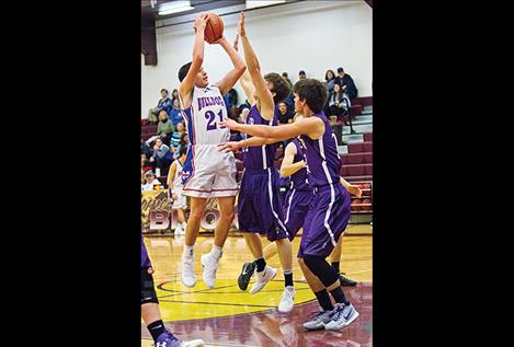 Mission Bulldogs Wacey McClure aims for the hoop.