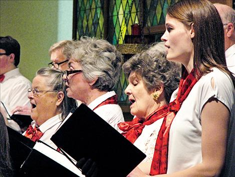 Evelyn Stanley, Nancy Teggeman, Jan Dybdal and Betsy Wade sing at Sunday's annual   Christmas concert.