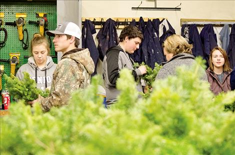 Mission Valley FFA students build wreaths to raise funding for programs that allow them to learn about job skills and food production.