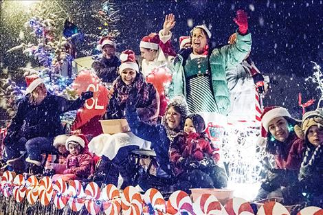 Falling snow comes down on a float in the Parade of Lights on Friday.