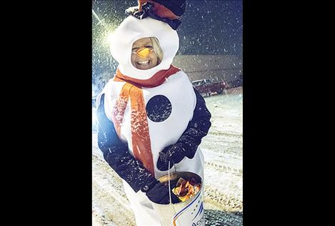 Cheryl Hackman and other Access Montana parade participants cleverly disguised themselves as snowmen while handing out candy during Ronan's lights parade