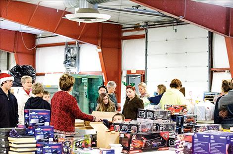 Mission Middle School students visit the Share the Spirit warehouse in Polson to drop off gifts.