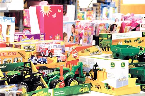 People donate toys to the Share the Spirit program and Toys for Tots.