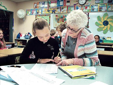 Foster grandparent Robin Burland regularly volunteers at Linderman Elementary School. Burland has said that even if the program ends, she'll continue to come help at the school.