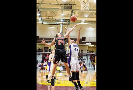 Ronan Maiden Madeline McCrea battles Polson Lady Pirate Olivia Perez for the rebound.