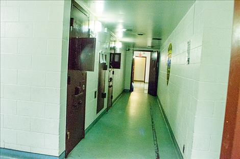 Jail cells are located behind metal doors, down a long hallway. Sheriff Bell  says the layout is inefficient.