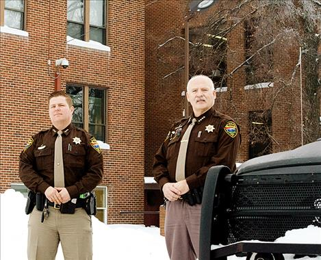 Lake County Undersheriff Ben Woods and Sheriff Don Bell stand outside the Lake County Courthouse where the jail is located. The two law enforcement officers developed an overflow document, posted on Facebook, to show the community how many people are released from jail each week due to a lack of space within the jail.