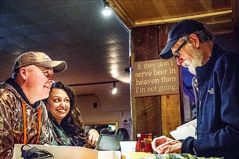 Prospective owners and steering committee member Heidi Fleury share conversation during a Dec. 2  ownership drive that raised more than $26,000 for Montana's first coop-owned brewery.