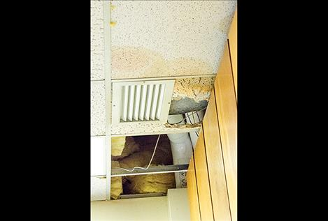 Ceiling tiles broke apart when water pushed its way into the classroom.