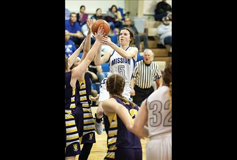 Lady Bulldogs Afton Brander shoots over defenders.