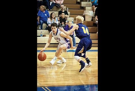 Bulldog Wacey McClure dribbles past the defender.
