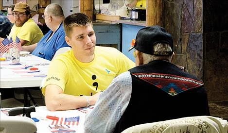 Army veteran Jeff Newton talks to other veterans during the event.