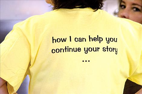 The back of the YLM's shirt encourages people to ask volunteers about resources to help prevent suicide.