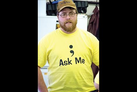 "Army veteran Justin Blevins wears one of the ""Ask Me"" shirts created by the Your Life Matters Project volunteers to bring awareness to suicide issues."