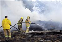Grass fire destroys trailer house